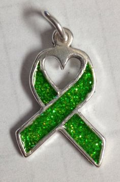 Silver Kidney Cancer Awareness Ribbon Charm with Heart Center and Glitter Inlay. $25.00, via Etsy. awareness charm