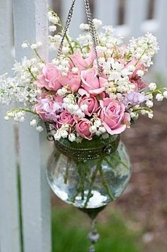 Beautiful pink roses and lilies of the valley, and are those other flowers white lilacs. Perfection!