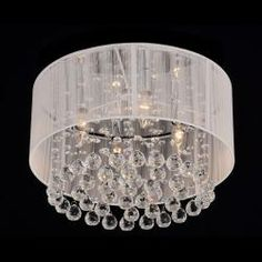 This mondern yet classy chrome and crystal chandelier is made with a strong iron base. Dazzling crystals dangle from the white fabric shade.