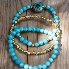3 elastic bracelet of Turquoise and Golden beads by MartaDissenys