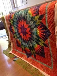 Summer solstice by Ginger. Pattern by Judy Neimeyer. Quilted by LibiepDesigns