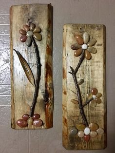 Sawed these two pieces of wood off of a pallet, sanded and stained them. Used e6000 glue to affix the stones, pod and twigs. Sprayed with clear acrylic to finish.