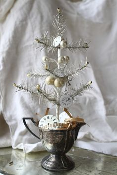 Repurposing Silver Plate - this is a cute way to display a vintage tinsel tree - via The Adventures of Elizabeth: A New Year to Endear