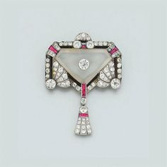An Art Deco diamond, ruby and onyx brooch