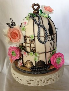 - Birdcage with flowers and pearls.