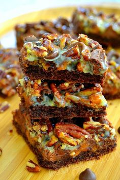 Piled high with deliciously sweet ingredients, these Turtle Seven Layer Bars serve as the perfect dessert for any occasion! They're so good, you won't be able to have just one!