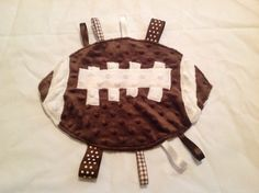 Items similar to Football Tag Blanket on Etsy Football Baby Blankets, Tag Blankets For Babies, Sewing For Kids, Baby Sewing, Football Baby Shower, Fidget Blankets, Baby Burp Cloths, Niece And Nephew, Baby Crafts