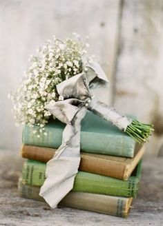 Love the bouquet on top of the books.  Very pretty.