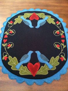 A Penny rug - A touch of folk art. A lot of respect for the work that went into this