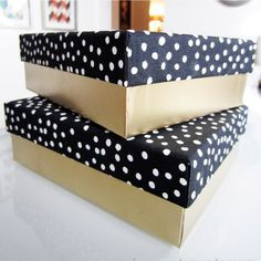 Upcycle old boxes with gold spray paint and fabric.  Cool storage for tax forms, photos etc