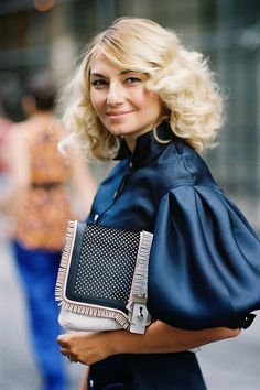 puffy sleeves and a fringy clutch - perfectly paired with a full set of locks