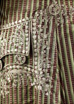 Detail embroidery, 3-piece suit, 1780-1785. Silk pékin with green stripes, lavishely embroidered with floral motifs in white silk, fabric-covered and embroidered buttons; waistcoat: cream silk satin, embroidered with multicoloured floral motifs.