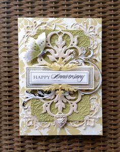 Anna Griffin Garden Windows card kit used with Lace Impressions cutting dies and embossing folder for the Cuttlebug. Miscellaneous heart button and pearls and rhinestone also added.