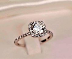 Love this setting with cushion cut center stone