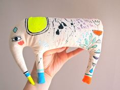 Hand painted Elephant decoration painted by JessQuinnSmallArt, £31.75 love the picasso , chagall style post modern style painted design on this primitive design retro 70's style plushie toy which makes it edge towards textile art so great gift for arty friends and adults as well as contemporary cool kids