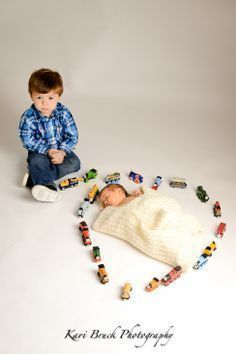 Newborn baby studio session. Newborn inspiration for baby pictures with a big brother who loves trains.