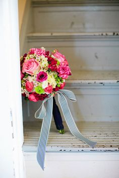 Bright pink bouquet - love the simple navy and white bow wrap.  Photo by Amanda Watson Photography http://www.amandawatsonphoto.com. www.wedsociety.com #pink #bouquets #ido