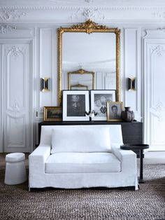 Paris style living room in white with beautiful plaster walls and golden accents