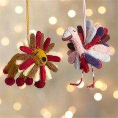 This adorable felt flamingo or lion proudly display fun multi-colored feathers or brightly colored mane, adding whimsy to the tree or holiday package. This ornament was handcrafted exclusively for Crate and Barrel at a factory in rural India that runs an environmentally sustainable operation using solar energy and recycled water.