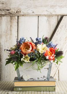 Welcome warm weather with a bushel of faux-flowers. This gorgeous look will last all the way until winter...or until you decide to shake up your favorite flower style!