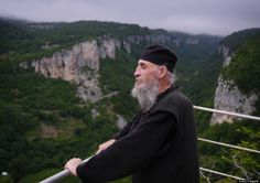 """Though isolated, he is not a total hermit, coming down once or twice a week to counsel the troubled young men who come to the monastery at the bottom for his help. After all, he was once one of them. Though he now lives at the top of the world, Qavtaradze found his vocation when he was the lowest he's ever been, doing prison time after he """"drank, sold drugs, everything"""" as a young man."""