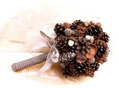 Rustic wedding bouquet pine cone country forest fall bridal flowers alternative.