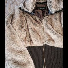 Darling faux jacket. Short faux/sweater blend jacket. Warm & comfortable. Excellent condition. Express Jackets & Coats