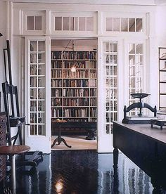 A home library ALMOST similar to that from Beauty and the Beast. Full bookcase wall, sliding French door entrance, surrounded by full length France windows, and topped with transom windows. Future House, My House, Le Logis, Sweet Home, Vintage Library, Home Libraries, Public Libraries, Library Design, Library Ideas