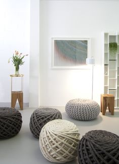 The shop& best-selling & Poufs,& by Dutch-based Christien Meindertsma, are knit with gigantic needles. In the foreground are Meindertsma& Texelaar Ottoman Poufs. The wooden Backenzahn stools are by Phillip Mainzer for and the ink-on-paper draw Eco Deco, Home Living, Living Room, Futons, Ideias Diy, Deco Design, Funky Design, Interior Design Studio, Home Accessories