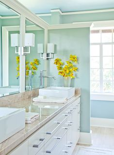 Nice colors. Beautiful spa bathroom from House of Turquoise. Wonder if it's possible to frame in a larger single mirror to make it look like 2 mirrors? Love the framing w lights.