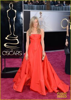 Jennifer Aniston continues the red-hot trend in a Valentino gown with Fred Leighton jewels #Oscars2013