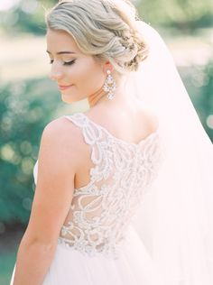 Dreamy sheer lace back wedding dress: Photography : Tracy Enoch Read More on SMP: http://www.stylemepretty.com/texas-weddings/2016/04/14/a-gorgeous-blush-texas-wedding-on-a-tight-budget/