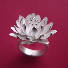 A lotus flower blooms gracefully with light that seems to glow from within...pinned by ♥ wootandhammy.com, thoughtful jewelry.