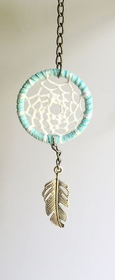 """This blue dream catcher keychain with feather charm is hand crafted so you can combat negative thoughts on the go. Hang it on your keys, purse, or just as decoration anywhere, even your car! Dream Catchers are a great These make wonderful meaningful gifts for any occasion including birthdays, holidays, or just """"thinking of you""""! These keychains are a great idea for party favors."""