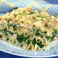 Sausage Alfredo Lasagna | Meals.com - Sausage Alfredo Lasagna is a creamy, dreamy variation on traditional lasagna. This recipe uses a rich Alfredo white sauce, and is packed with cheese, sausage and spinach for a trifecta of deliciousness. #comfortfood #lasagna #alfredo