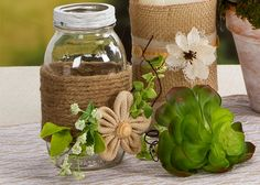 Mason jar wrapped with jute and flowers