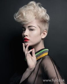 2012 short height hairstyle    A blonde crop was prepped with mousse and roughly blow-dried to add texture and volume. Hair on either side was smoothed back, with the top section curled with large tongs then styled with a matte-finish paste into a quiff.     Hairstyle by: Tim Hartley