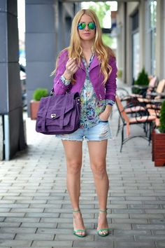 Purple and green mix for spring and summer. Purple cropped blazer and bag, green heels, floral top and ripped jean shorts.