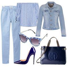 Pantaloni azzurri in cotone, vestibilità aderente; camicia in cotone azzurra con sottili righe bianche, maniche a tre quarti e spalle scoperte. la giacca di jeans è a maniche lunghe con tasche sul petto e chiusura a bottoni. Gli occhiali da sole con lavorazione maculata sono sui toni del blu e dell'azzurro. Le décolleté in finta pelle sono in vernice blu con tacco di 12 centimetri e la borsa a mano, Armani Jeans, è in vernice blu con tracolla in contrasto.