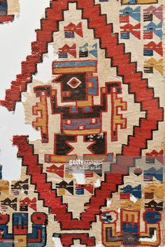 A detail in a colorful 105 x 77 centimeters weaving, depicting personalities within rhomboidal spaces is displayed at the Art Museum of Lima (MALI) on June 11, 2014, part of an exhibit that brings together a representative selection of the pieces recovered from a noblewomans funerary chamber of the Castillo (Castle) of Huarmey, belonging to the pre-Inca Wari Culture (600-1000 BC), in central coastal Peru, 276 kilometers north of Lima, from an excavation initiated in 2012. From this…