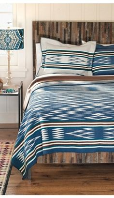 Tribal patterns hit the bedroom with a topaz blue bedspread, cushions and shade. Ikat Bedding, Blue Bedspread, Plaid Bedding, Bedding Collections, Home Collections, Cabana, Home Interior, Interior Design, Southwestern Home