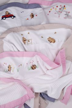 Beautiful cotton Tom & Bella cellular blankets with embroidered characters and check or baby spot trim available for sale online