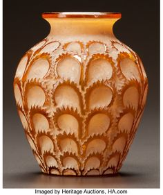 R. LALIQUE AMBER GLASS LAITERONS VASE WITH WHITE PATINA.Circa 1931. Stenciled R. LALIQUE, FRANCE. M p. 454