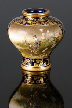A Kinkozan Satsuma Vase, c.1900, enamelled with a mother and child.