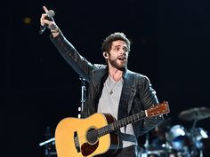 Thomas Rhett Jokes About His Recent Stage Tumble: 'None of the Fans Tried to Help Me Up – But They All Took Selfies' Country Boys, Country Music, Die A Happy Man, Brett Eldredge, Easton Corbin, Justin Moore, Jake Owen, Taking Selfies, Dierks Bentley