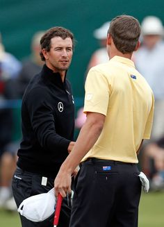 Adam Scott shakes the hand of amateur Oliver Goss at their final hole during day one of the Australian Masters at Kingston Heath Golf Club on November 15, 2012 in Melbourne, Australia