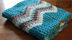 Blanket Crochet Crochet Breakaway Waves Blanket by Jeanne Steinhilber - Crochet Breakaway Waves Blanket When I stumbled across the Bernat Baby Blanket Stripes yarn in Tiny Teal, I immediately knew I wanted to crochet a chevron Crochet Ripple, Crochet Afgans, Crochet Dishcloths, Crochet Yarn, Irish Crochet, Easy Crochet, Bernat Chunky Yarn, Chunky Crochet, Crochet Baby Cardigan