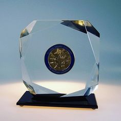 A unique way of embedding a commemorative coin in lucite, this multi-faceted piece is one we did for The gold medal coin was embedded and mounted on a black base, showcasing the beauty of the coin in an elegant way. Commemorative Coins, Base, In This Moment, Elegant, Unique, Gold, Beauty, Design, Classy