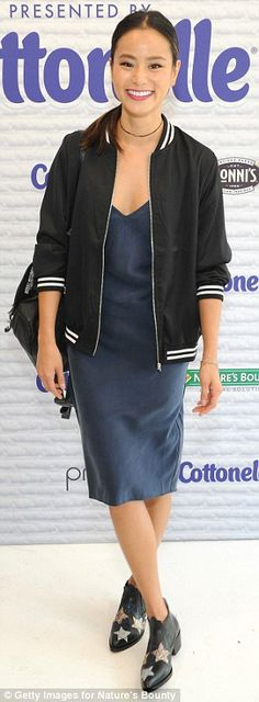 Chic: Jamie Chung cut a casual figure in a dark blue dress and black and white…