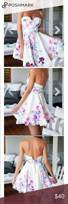 NWT Flower Bomb dress Never worn, perfect condition, size 2 US, think hem to keep it in full swing, slightly padded with removable straps Xenia Boutique Dresses Mini